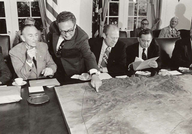 President Gerald Ford studies a topographic model made from aerial photography.  Courtesy of Gerald R. Ford Library
